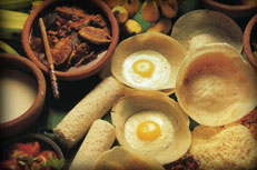Sri Lankan cuisine including egg hoppers, pittu