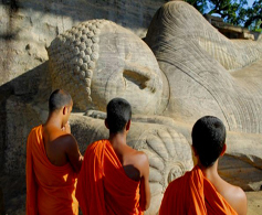 Monks worshiping a stone sculpture of Lord Buddha